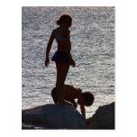 Children play along the rocks, Divi SXM Postcards