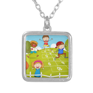 Children playing hopscotch in the park square pendant necklace