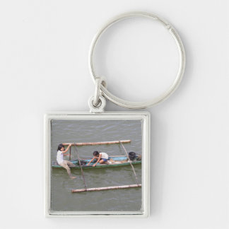 Children playing in a fishing boat Silver-Colored square keychain