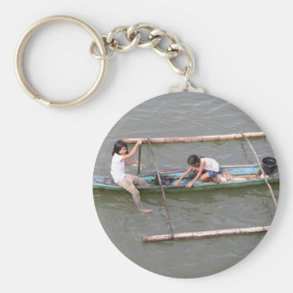 Children playing in a fishing boat basic round button keychain