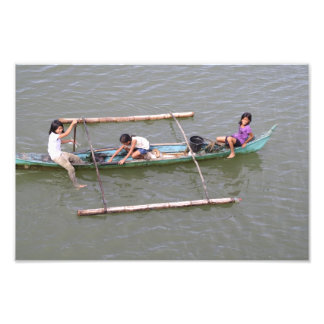 Children playing in a fishing boat photo print