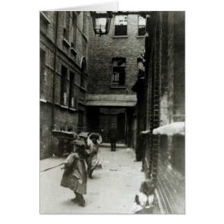 Children playing in a slum, 1899 card