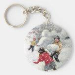 children playing in snow basic round button keychain