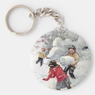 children playing in snow keychain