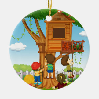 Children playing on the treehouse ceramic ornament