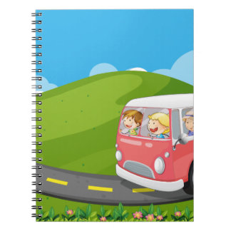 Children riding in a van notebook