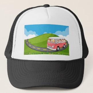 Children riding in a van trucker hat