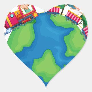 Children riding on train around the world heart sticker