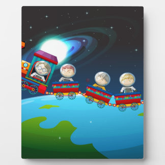 Children riding train in space plaque