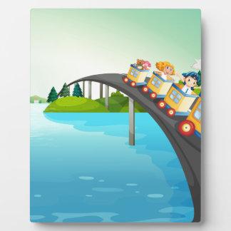 Children riding train over the bridge photo plaques