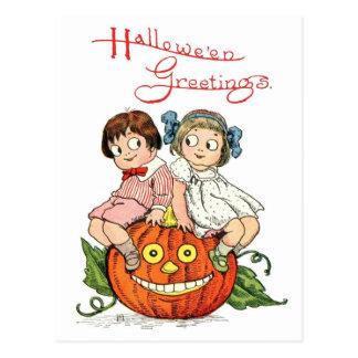 Children Sitting on Pumpkin Head Postcard