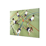 Children sitting on the floor of a sports hall canvas print