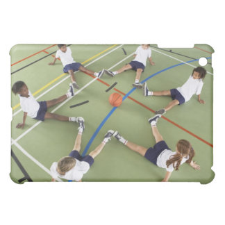 Children sitting on the floor of a sports hall iPad mini cover