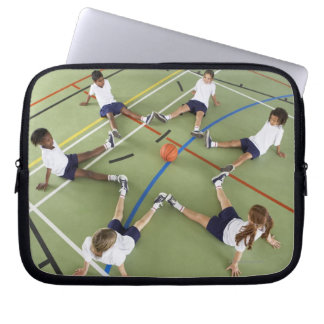 Children sitting on the floor of a sports hall laptop computer sleeve