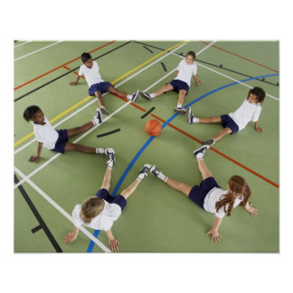Children sitting on the floor of a sports hall print