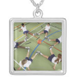 Children sitting on the floor of a sports hall square pendant necklace
