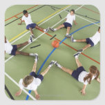 Children sitting on the floor of a sports hall square sticker