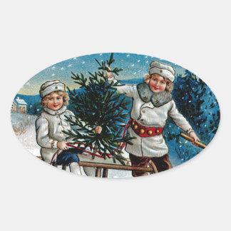 Children Sledding Oval Sticker