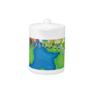 Children standing around the world teapot