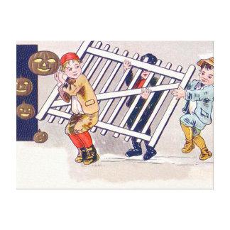 Children Stealing Fence Jack O Lantern Canvas Print