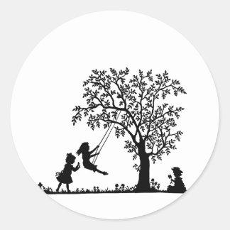 CHILDREN THREE PLAYING ON A TREE CLASSIC ROUND STICKER