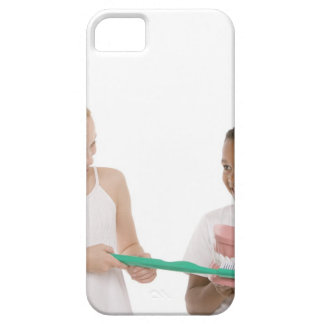 Children with a model set of teeth and oversized iPhone 5 cover