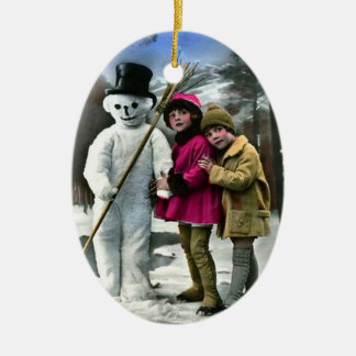 CHILDREN WITH SNOWMAN CERAMIC ORNAMENT