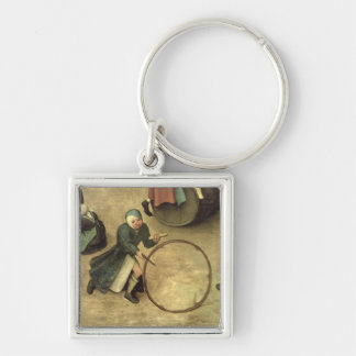 Children's Games : detail of a child with a Silver-Colored Square Keychain
