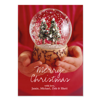 Child's hands holding snow globe card