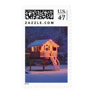 Childs playhouse with snow and Christmas lights Postage Stamp