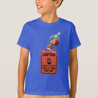 Childs t-shirt with balls flying at a caution sign