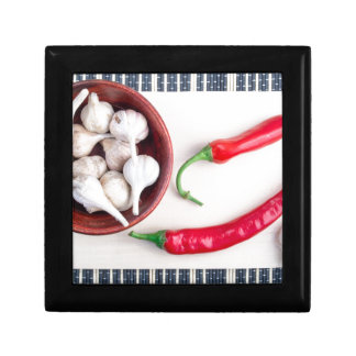 Chilli peppers and garlic in a wooden bowl jewelry box