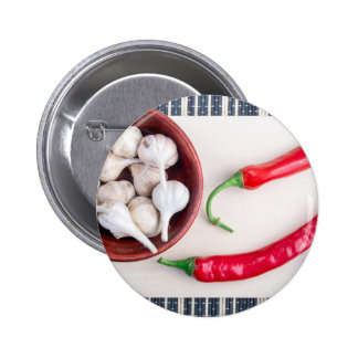 Chilli peppers and garlic in a wooden bowl pinback button