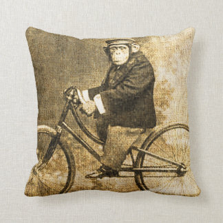Chimpancé del vintage en una bicicleta cojines