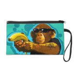 Chimpancé que sostiene un plátano