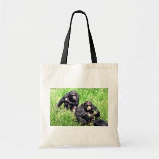 Chimpancés que comen la hierba (niño de la nota) bolsa tela barata