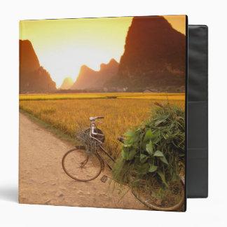 China, Guangxi. Yangzhou, Bicycle on country Vinyl Binder