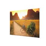 China, Guangxi. Yangzhou, Bicycle on country Canvas Print