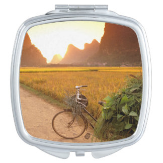 China, Guangxi. Yangzhou, Bicycle on country Mirrors For Makeup
