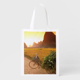 China, Guangxi. Yangzhou, Bicycle on country Reusable Grocery Bags