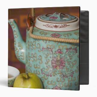 China, Hong Kong. Traditional Chinese teapot & 2 3 Ring Binder