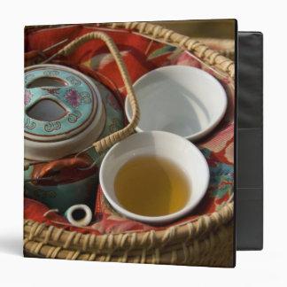 China, Hong Kong. Traditional Chinese teapot & 3 3 Ring Binder