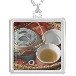 China, Hong Kong. Traditional Chinese teapot & 3 Silver Plated Necklace