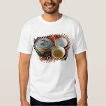 China, Hong Kong. Traditional Chinese teapot & 3 T Shirts