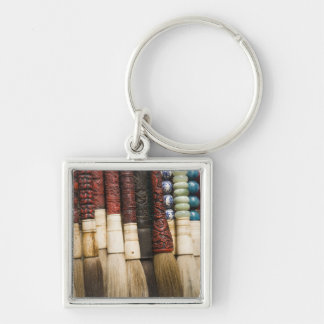 China, Shanghai. Brushes Chenghuang Miao Silver-Colored Square Keychain