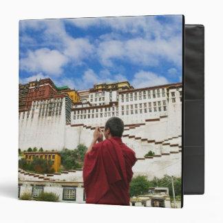 China, Tibet, Lhasa, Tibetan monk with Potala 3 Ring Binder