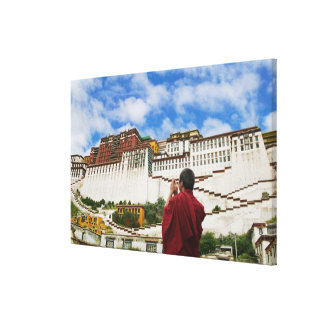 China, Tibet, Lhasa, Tibetan monk with Potala Canvas Prints