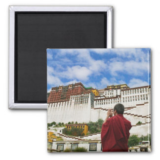 China, Tibet, Lhasa, Tibetan monk with Potala Magnet