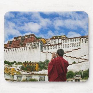 China, Tibet, Lhasa, Tibetan monk with Potala Mouse Pad