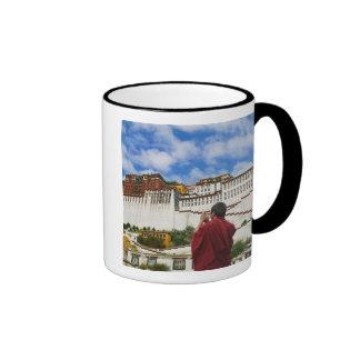 China, Tibet, Lhasa, Tibetan monk with Potala Ringer Mug